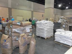 The raw food materials came in large sacks. These sacks were hauled around by volunteers to replenish the four main ingredient boxes at the food packaging stations.