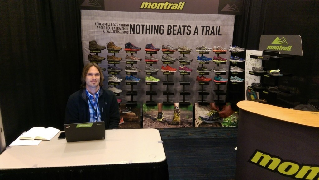 Eron Osterhaus of Montrail shows off some of their new trail running shoes in-between meetings with vendors.