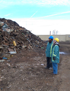 John Powers, University of Tennessee assistant professor of sculpture, and student Paige Smith survey the massive piles of discarded metal and steel at Gerdau's scrapyard Jan. 31.